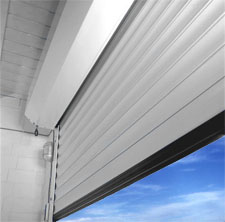 Porte de garage enroulable motoris e filaire blanche for Reglage porte de garage enroulable somfy